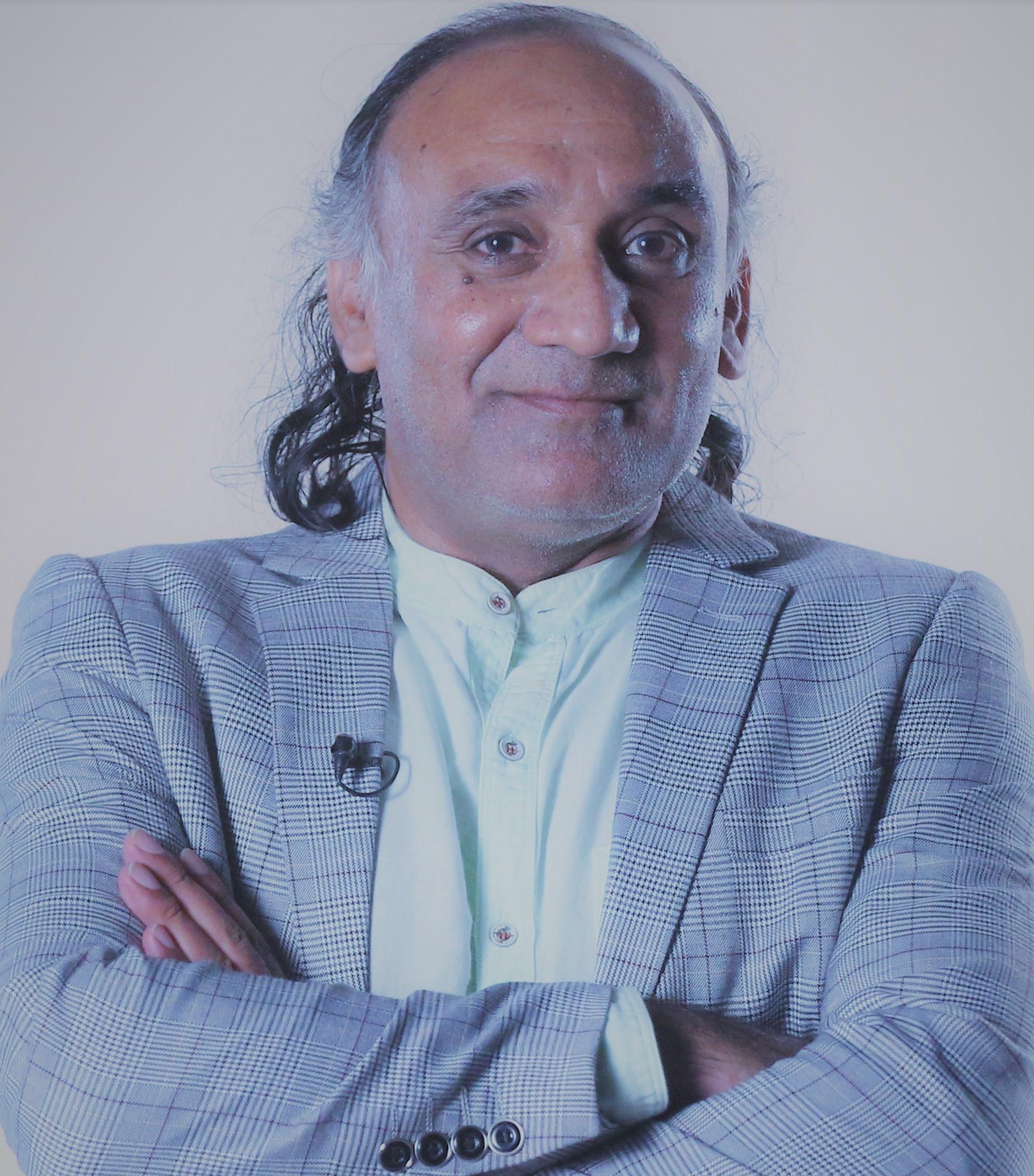 Dr. Pramod Kumar